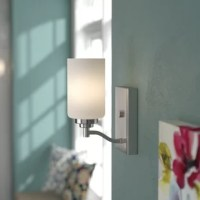 Bring some enhancing illumination to your walls with this one-light armed wall sconce. A contemporary silhouette, this sconce offers simple, modern-inspired style. Made of metal, this hardwired luminary is perfect as a bedside, vanity, or powder room lamp. A white frosted glass shade conceals one medium-base incandescent lightbulb of up to 60 W (bulb not included). It can mounted facing either up or down. This fixture measures 9'' H x 4.5'' W x 6.25'' D.