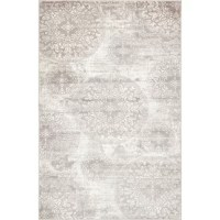 Set an airy and on-trend foundation in any arrangement with this area rug, showcasing a floral medallion motif in neutral light gray and ivory tones that can complement most color palettes. Power-loomed in Turkey from polypropylene with a low 0.25