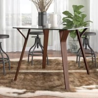 With its pleasant, inviting design and Mid-Century lineage, the dining table will soon be the epicenter of your casual gatherings. Featuring a slightly-rounded square top and splayed tapered legs, the dining table represents a clean, modern form at its finest.