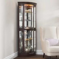 Beautifully display your curated collections with pride in this lighted corner curio cabinet. Measuring 76