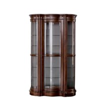More than just a spot to stash your curios, this commanding cabinet with serpentine doors demands attention. Measuring 80'' H x 49'' W x 17'' D, its statement-making size draws focus to your precious collection. Constructed in rich brown manufactured wood, this stunning piece fits right in in any home with a traditional aesthetic. Mirrored backing reflects your keepsakes, while the two LED lights (included) can be adjusted with a three-way dimmer switch to control the amount of light your items...