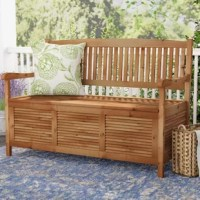 Kick back and relax on your patio or porch with this acacia wood garden bench! Crafted of solid acacia wood in a weather-resistant finish, this bench features a full back, track arms, and four straight square legs, while its base includes louvered panel sides. This bench has a 600-lbs. weight capacity. Just lift up its slatted seat to reveal hidden storage space for pillows and blankets.