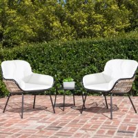 Create a cozy backyard getaway with this 3 Piece Seating Group with Cushion. Perfect for small environments and unused corner areas, this contemporary set can transform any environment into an attractive conversation space. This space-saving set includes two accent chairs, complete with 4-sided cushions, and an end table. The unique, open-weave design will draw you in for a closer look and once you take a seat, you're suddenly immersed in comfort as the extra-plush cushions cradle you from...
