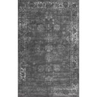 A traditional design gets a trendy update in this dark gray area rug, showcasing an overdyed oriental motif. Made in Turkey, this area rug is power-loomed from stain and fade-resistant polypropylene in a low 0.25