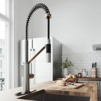 With its sleek design and modern spiral details, the VIGO Livingston Magnetic Kitchen Faucet with a deck plate is the perfect functional fixture for your kitchen. The single handle kitchen faucet features a professional look with an easy to clean spray face. The pull-down spray head switches from aerated flow to spray at the touch of a button for powerful cleaning. An integrated magnetic catch holds the spray head in place when not in use for additional convenience. This model comes with a...