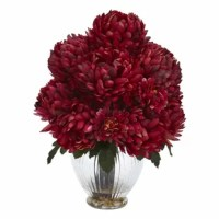 This Mum Artificial Floral Arrangement in Vase bursting out from the included vase, it features a dense cluster of large blooms with dark green leaves underneath. It will look great on top of your work desk, low bookcase, or small side table, or it can be placed on your marble countertop near the window to make a bold statement.