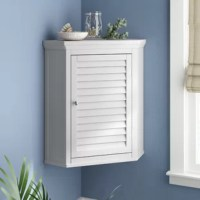 Is your bathroom short on square footage? This corner wall mounted storage unit could be just the answer to save floor space, otherwise taken by larger storage options, while also providing you with enough to storage for crisp hand towels, toiletries, and cleaning supplies. Perfectly at home in traditional or coastal aesthetics – this piece is crafted from manufactured wood, in a neutral hue, and features one adjustable interior shelf. Measuring 24'' H x 22.5'' W x 15'' D, this piece requires...