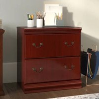 If your desk is getting buried beneath important memos, reports, and files, it's time to get organized with a handy cabinet like this. Perfect for clearing away office clutter, this piece features two drawers on soft-close glides perfect for hosting legal and letter-size files. Crafted from manufactured wood with a cherry finish, this piece features crown and foot molding, as well as handle knockers, for a traditional look in any space.
