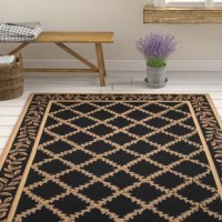 Add some style and panache to your bedroom or living room with this Kinchen Hand-Hooked Wool Black Area Rug. Ideal for indoor use, this Kinchen Hand-Hooked Wool Black Area Rug features a stylish cross pattern with gold floral motifs, which perfectly blends with other similar modern style furniture. This area rug is handmade using 100% pure wool and a hooked weaving method that imparts it with improved durability and sturdiness. This Kinchen Hand-Hooked Wool Black Area Rug comes with cotton...