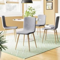Enjoy a mid-century-inspired dining experience, sans TV dinners, on this streamlined dining chair. Its contoured seatback, upholstered in cotton fabric, offers a sturdy seat as it conserves space, while tapered metal legs, awash in a wood-look finish, complete the look down below. Even better, each leg is fitted with floor glides to prevent scratches and scuffs. Plus, its armless design pulls up flush to tables and leaves plenty of elbow room for existing furniture. Four chairs included.