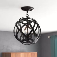 A little illumination goes a long way it still brings a bit of style and shines to your entryway or kitchen ensemble. Crafted from metal, it pairs an eye-catching, openwork globe shade with a dark finish that's versatile for a variety of spaces. Assembly and installation are required for this hardwired luminary.