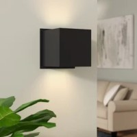 When it comes to mood lighting, your fixture can make it or break it. Find the light you love with this Macaulay Directional 2-Light LED Outdoor Sconce. Affixed to your wall on a metal plate, this piece features a square design that works well in any modern aesthetic. A metallic shade directs light up and downward from an integrated LED bulb, while a wet location rating makes this product the perfect pick for lighting up your outdoor arrangement. Plus, this item comes backed by a five-year...
