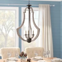 Doubling as a functional source of light and a striking focal point, this versatile three-light lantern pendant brings a dash of modern farmhouse flair as it illuminates any arrangement in your home. Crafted from metal in a weathered pine finish, this fixture features an openwork geometric silhouette with curved sides and a single tier of exposed 60 W incandescent bulbs (not included) in the center. The manufacturer backs this product with a one-year warranty.