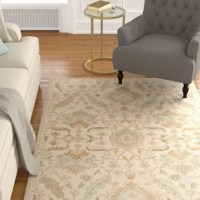 Bring a touch of breezy style and simple sophistication to your space with this Kempinski Hand-Tufted Beige/Tan Area Rug, featuring a bold floral motif in neutral beige tones. Set it under a warm wood coffee table in the living room to anchor your ensemble, then arrange linen-upholstered sofas and armchairs for an understated seating group. To play up the patterned design, top off your seats with matching teal and green floral throw pillows, then arrange pierced garden stools and stitched pouf...