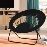 Lightweight, portable, and collapsible, this compact Papasan chair is the perfect pick for your teen's room. Founded atop a tubular metal frame in a powder-coated finish, this design can fold completely flat for storage, making it easy to throw in the car or tuck away when you want to create space. The circular seat is made up of polyester fabric for an inviting feel, while measuring just 27'' H x 32'' W x 32'' D, it fits in easily with your arrangement. Plus, it has the capacity to support...