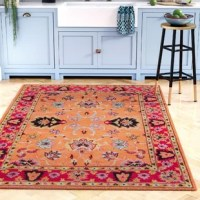 Set a boho-chic foundation for your stylish space with this Laduke Handmade Tufted Wool Orange Area Rug, showcasing hues of orange, pink, lime green, and dark blue. Made in India, this area rug handwoven from 100% wool in a thick 0.5
