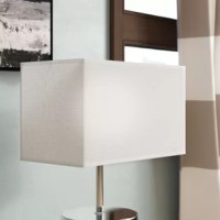 Give any lamp a modern twist with this chic shade, perfect for updating an end table display or your master suite nightstand. Taking on a clean-lined rectangle silhouette, this design is contemporary, but works just as well in more transitional aesthetics. Lined with linen in off-white, its 18.5'' W x 10'' D x 11'' H frame evenly distributes the light throughout your ensemble. A steel spider attachment allows for easy installation.