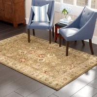 Inspired by 19th-century Persian designs, this brown and beige area rug lays an ornate foundation for your space with its elegant oriental motif. Made in India, this area rug is hand-tufted of 100% premium wool in a medium 0.43