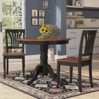 Craft a cozy and classic entertainment space in any room with this lovely five-piece dining set, perfect for the homemaker with an eye for timeless design. Featuring a round pedestal table with four matching openwork side chairs, this design offers a traditional twist to your space, while its solid rubberwood frame offers lasting and durable appeal to your ensemble. Set it in the eat-in kitchen over a light cotton rug for a cozy dining nook in the heart of your home, then hang down a drum shade...