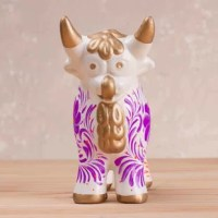 Telling the traditional folktale of El Torito de Pucará, this figurine depicts a sacrificial bull that provided the town of Pucara with water by piercing the side of a mountain. The artisan of Peru pays homage to the Pucara bull, presenting this small white figurine that is hand-painted with colorful floral designs and gold-tone accents.