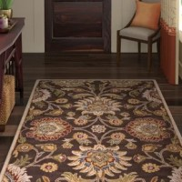 Warming up hardwood and tile floors while setting the stage for the rest of your ensemble, area rugs are essential for nearly any room in your abode. Made in India, this one is constructed from wool, a hypoallergenic and eco-friendly fiber that naturally resists flames, dust mites, and mildew. It features a 0.39