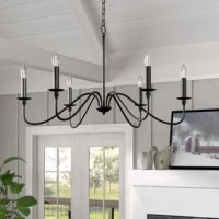 Perfect for catching attention like no other lighting fixture, chandeliers feature striking designs and bold illumination for a touch that's sure to elevate any space. Take this piece, for example: featuring six candle-style lights attached to curving arms, this piece is an understated option for a classic style in any ensemble. This luminary accommodates six 40 W candelabra bulbs, although none are included. This generously portioned piece is best suited to larger spaces like living rooms and...