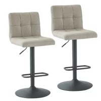 Sitting at the perfect height for kitchen islands, breakfast bars, and pub tables, barstools have a leg up on other seating options. This 32'' H, 360° swivel stool is crafted from a metal found in a dark gray hue and showcases gray polyester upholstery with square tufted stitching details. It sits atop a rounded base for stability and features a footrest for comfort, as well as a handy pneumatic lift to adjust seat height.