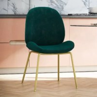 The Astor Upholstered Dining Chair is unapologetically chic and totes comfortable. With its classy rounded shape, glam velvet upholstery, and sleek brass metal legs, this chair will perfectly complement your dining table or accentuate your home office when you're working from nine to wine. The Astor Upholstered Dining Chair is made with a sturdy wooden frame and foam padding to support your buns. The struggle is real, so it requires minimal assembly.