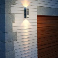 Easily add a touch of contemporary design with this Modern 2-Light Outdoor Sconce with a premium glass lens. This is the perfect outdoor light sconce to enhance the beauty of your home exterior. It blends easily with a variety of home exterior and interior styles.