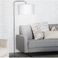With a slender silhouette, this floor lamp brings a touch of mid-century charm – and plenty of light – to your space. Set atop a round base, this fixture is crafted from metal, featuring an arched body that ends in a hardback drum shade to soften the glow of a single bulb (not included). A footswitch makes it easy to turn this design on and off.