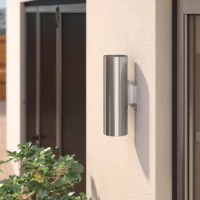 Bring a simple touch of sleek sophistication to any space around your home with this understated outdoor wall sconce, featuring a cylindrical design, and simple metal design. Set it on your front porch to light and welcome guests in a simple style, or hang it up on your veranda to bring a touch of warm ambiance to your alfresco ensemble. For a cohesive look in your space, arrange clean-lined tables and understated acacia wood seats around the space, then set out shimmering silver-finished...