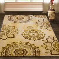 """A burst of ornate floral medallions scatters across the Canfield Area Rug. Made with 100% Nylon fibers and a 0.31"""" pile height, this rug can handle high traffic areas of your home while remaining soft and long-lasting. The rich golds and neutrals blend together with the decadent pattern of this rug and create a truly elegant piece. Complement your decor in the foyer or entryway, back door, living room, dining room, kitchen, in front of the fireplace, hallways, and bedrooms with this beautiful..."""