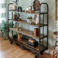 The bookcase With Shelves is a favorite from the Foundry Select. The sturdy industrial wood and metal construction gives this piece a timeless look that can work in any room. Load the shelves with books, pot and pans and more. The heavy-duty wheels make moving the shelf easy. The top three shelves are trimmed with a metal while the wooden slats on the base are framed with sturdy metal sides. Hand Worked Steel and reclaimed old growth lumber make this creation a wonderful mix of Industrial and...
