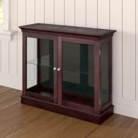 Accent dining areas or living rooms with this display cabinet, perfect for hosting your favorite curios. Crafted from manufactured wood in a cherry hue, its neutral finish is perfect for any color palette you pick. It measures 30'' H x 36'' W x 12'' D, and showcases a traditional look perfect for any aesthetic. Inside, an adjustable tempered glass shelf hosts your glassware, serveware, or knickknacks, and displays them through the glass doors.