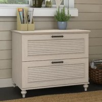 This file cabinet offers two file drawers, plus style touches like louvered accents and decorative bun feet.