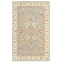 The hallmark of any handsome home is a fine foyer - and you only need a few eye-catchers to really make it pop! Set the tone on the floor below with this alluring area rug, timeless addition to your elegant abode. Made in India, it is tufted of wool with cotton canvas back. Though its hues of blue and beige are cool enough to blend right in, an intricate Persian-inspired motif effortlessly draws the eye. After you've laid the foundation, head straight up to the ceiling to make your space shine...