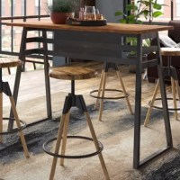 Pub tables are perfect for bar areas, or dining areas short on square footage. Take this table for example, with sled legs, in a neutral brown and gray color palette that can blend in with most other color palettes – you can pair it with your choice of pub chairs or bar stools. Perfect for an industrial aesthetic, this rectangular table is constructed from metal and manufactured wood, in a powder coated finish. It measures 42'' H x 59'' L x 24'' W.