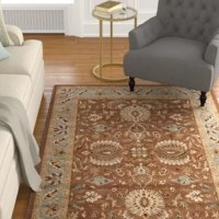 With rich, luscious detailing and a vibrant feel, this collection brings life to any space. Hand-tufted of pure wool with strong cotton backing, these traditionally beautiful rugs can withstand even the most highly traveled areas of your home.