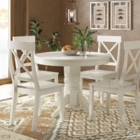 Set a classic foundation in your entertainment ensemble with this five-piece dining set, perfect for smaller dining space. Crafted from solid rubberwood, this set includes one round table with a pedestal base and four matching chairs. Though the open X-shaped design of the chair backs gives this set a traditional look, a neutral finish ensures it's versatile enough to coordinate with a variety of color palettes and aesthetics. Assembly is required.