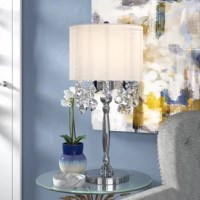 Perfect for adding a touch of style while they light up a room, table lamps are versatile, space-conscious lighting fixtures – and we can't get enough of them! This piece, for example, makes for a glamorous option on any surface. Crafted from a chrome base and capped with a fabric drum shade, this piece is defined by its crystal accents. Perfect to catching the light while they hang, these crystal ornaments are great for a chic pop of glam. A 40 W bulb is included, saving you a trip to the...