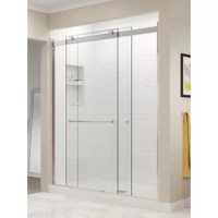 With its semi-frameless design and sleek header, the Basco Rotolo Sliding Shower Door adds a modern touch to your shower enclosure. This door features a dual bypass rolling design and uses two rollers and an anti-jump mechanism to ensure smooth opening and closing. Crafted from ultra-durable safety-tempered glass, the two 1/4-inch thick heavy-cut clear glass panels beautifully showcase the interior of your shower. The reflective, lustrous chrome finish and sleek, gently curved towel bar add to...