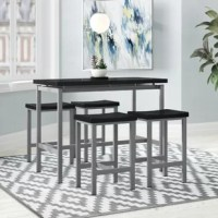No matter the shape or size, dining sets play an integral role in our home. Create a compelling and cohesive aesthetic in your abode with this one – which includes one table and four stools. Crafted from metal, the table and stools both feature streamlined bases awash in a silver finish, while their manufactured wooden tops showcase a black hue, lending a uniform look. Feeling right at home in any contemporary arrangement, this set works well as a breakfast nook, and even comes backed by a...