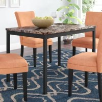 With a scale appropriate for any number of smaller dining spaces, this Nydam Dining Table will provide the look and style you want in your home.