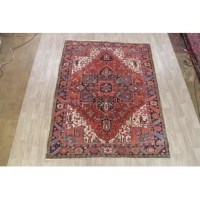 A beautiful geometric area rug hand-knotted by skillful weavers in Central Asia made with 100% wool. These used hand-knotted rugs are professionally washed and cleaned.