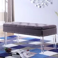 From providing a place to sit while you take off your shoes to opening up seating options when you've got a full house, benches are always a stylish selection in your home. Take this one for example: Perched atop clear acrylic legs for some instant glam appeal, this piece boasts a rectangular silhouette that's designed to support up to 200 lbs. after assembly. Upholstered in a polyester blend, it showcases tufted accents for an inviting feel, while nailhead detailing gives it some...
