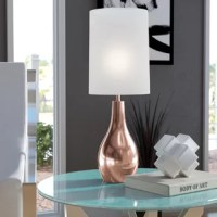 Simplistic and sleek, this 20'' table lamp offers a polished finishing touch for any ensemble. Crafted from metal, its base takes on a curved teardrop silhouette and showcases a metallic finish for a look that works well in both classic and contemporary settings. Up top, you'll find a single light highlighted by a cylindrical fabric shade that evenly distributes a warm and relaxing glow over your nightstand or console table.