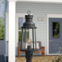 Handy for brightening up the night, post lamps are handy for their ability to be placed wherever you need them the most. Take this lamp, for example: Crafted from dark bronze-finished metal, this piece strikes a lantern-style silhouette and features clear seeded glass panels. This luminary accommodates a single 100 W bulb, although none is included and is solar-powered, so you don't need to worry about complicating outdoor wiring. And since this piece is designed with wet spaces in mind, it'll...