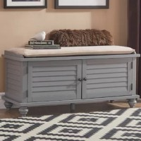 Founded upon four turned bun feet and showcasing a solid color finish, this wood storage bench brings function and flair to any unused space in your home. Its velvet upholstery adds sophisticated style to your decor, while its slatted panels bring breezy flair to both casual and formal aesthetics. Play into this piece's nautical influence by adding it to an ocean-inspired entryway arrangement or bedroom. Perfect for storing spare blankets in the den or umbrellas and other on-the-go essentials...
