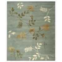 Lend your floors a luxurious lift with this fabulously floral area rug. Hand-tufted in India from premium New Zealand wool, this transitional design showcases an asymmetrical botanical motif in soft hues of light blue with beige and ivory accents in a medium pile. Establish a curated aesthetic in your bedroom by rolling this rug out for a pleasant pop of pattern, then place a simple one-drawer nightstand on each side of a linen upholstered platform bed with a button-tufted headboard. Dress a...
