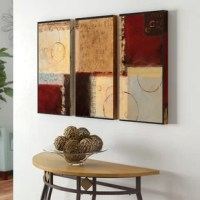 Wall art is a great way to break up an empty wall and add some whimsy to your room. Take this three piece set of abstract wall art for example: printed on gallery wrapped canvas and wrapped around solid wood stretchers, it features abstract images in a red, brown, and Burnt Cream color palette. Made in the USA, this piece should be hung horizontally, and arrives ready to hang, with included wall mounting hardware.